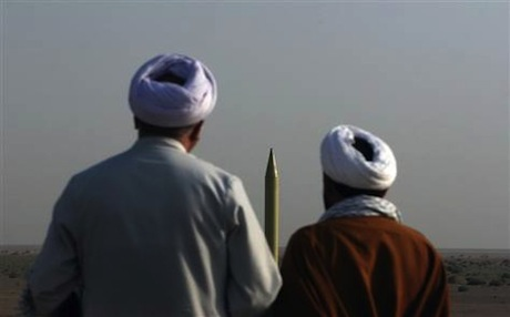 Iranian clerics look at a Shahab-1 missile during a military exercise in the Iranian desert. Photo: AFP