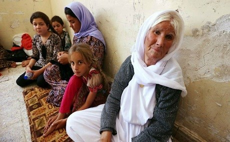 A Kurdish Yazidi family fled following ISIS attack on the northern Iraqi town of Shingal in August 2014. Photo: AFP