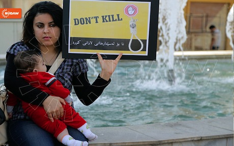 A Kurdish woman protesting against the execution of Kurdish prisoners in front of the Iranian consulate in Erbil.