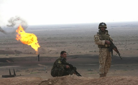 Iraqi commandos survey Fauqa Oilfield in Maysan province. Photo: AFP