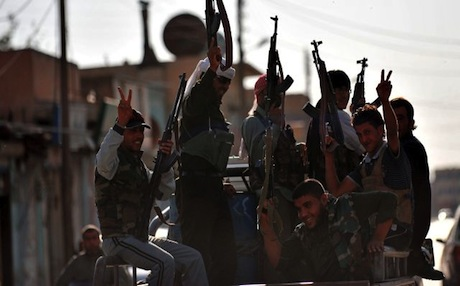 Syrian rebels make victory signs in the town of Tal Abyad near the border with Turkey. Photo: AFP
