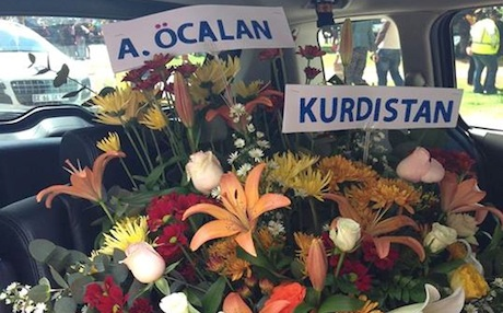Flowers sent by Abdullah Ocalan to the funeral of the late South African leader Nelson Mandela. Photo by Christiane Amanpour.