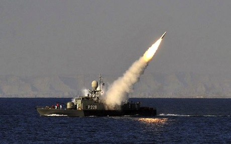 An Iranian navy vessel launches a missile during a drill at the sea of Oman. January 2012. Photo: AP