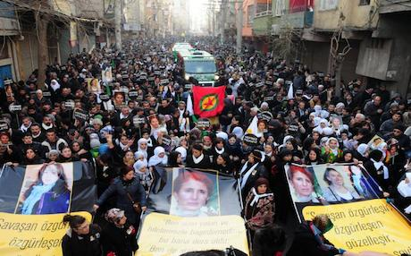 Thousands of Kurds carry banners in Diyarbakir in January 2013 bearing pictures of Cansiz and two associates killed in France. Photo AFP