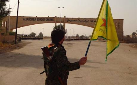 A YPG fighter at the Tel Kocer border crossing. Photo: PYD/Facebook
