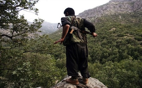 A PKK fighter looks across the border into Turkey. Photo: AFP