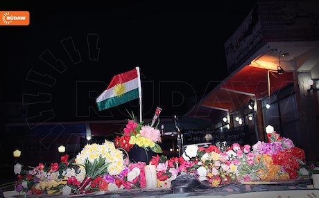 A Kurdish flag and flowers in Khanaqin at the site of a suicide bombing that killed 20 people at a PUK election rally in April. Photo: Rudaw