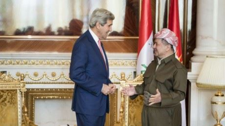 Kerry and Barzani exchange greetings before going into a meeting. Photo: AFP