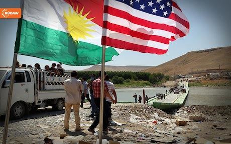 Kurdistan and US flags welcome rescued Yezidi civilians into the Kurdistan Region.